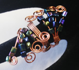 copper ring, irr. glass black beads