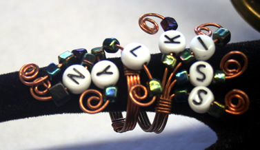 Wire ring with baby bead words.
