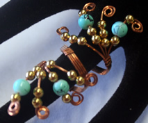 sopper wrapped rings, with gold and howlite beads